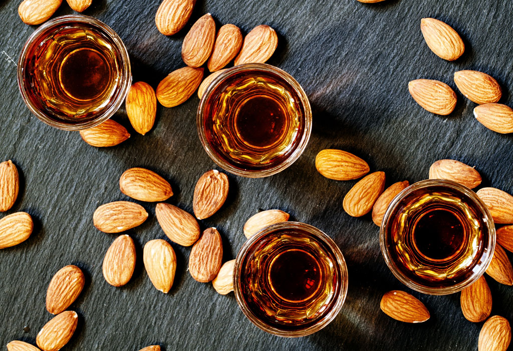 Amaretto almond liqueur with a dark background, top view