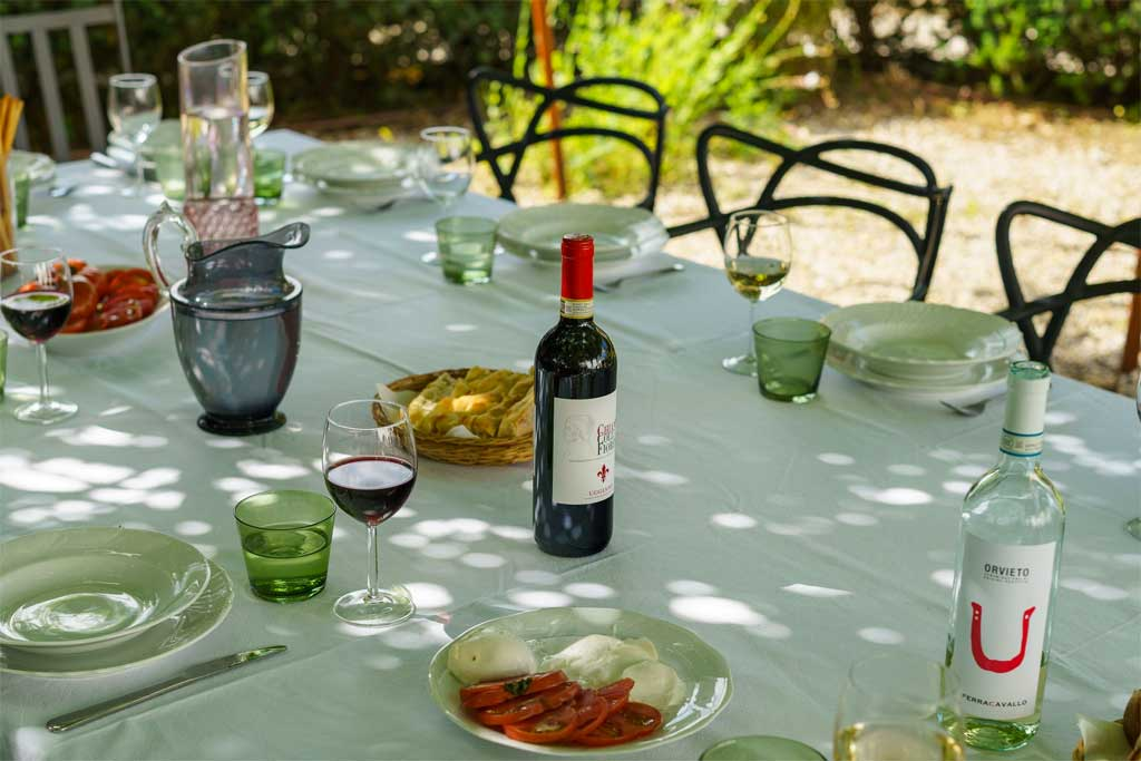 Table with wine and food in a villa in Chianti