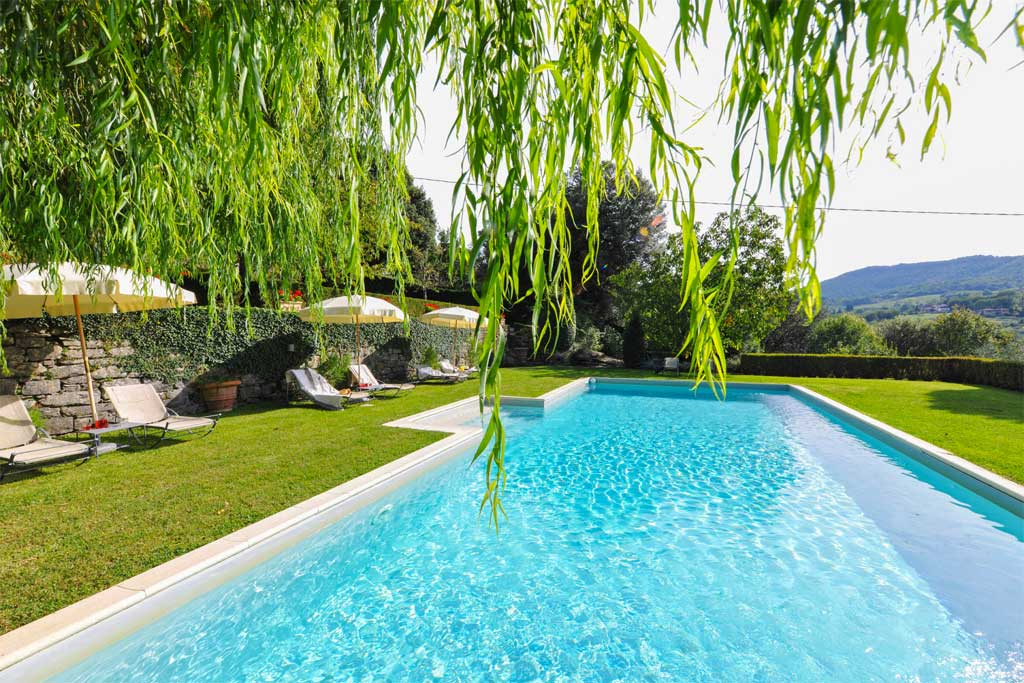 Enjoy the large pool and the beautiful views at Villa di Masseto