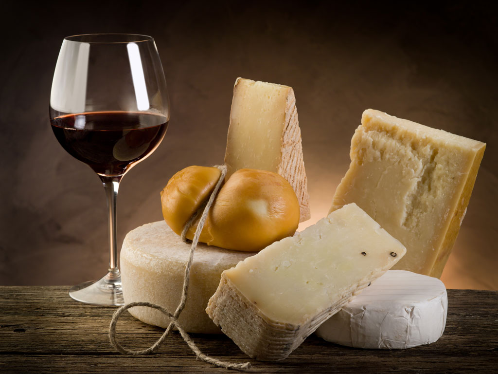 Tuscan wine with aged cheese