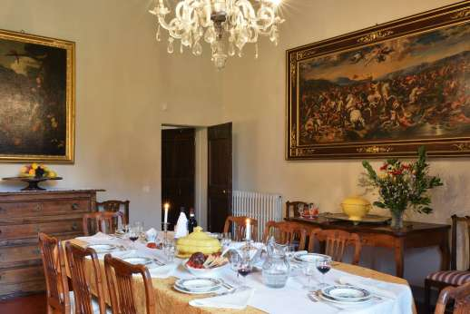 Villa di Bonorlo - Dining room with fireplace and original artwork.