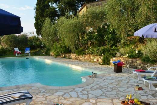 Il Giogo - The swimming pool has been strategically located on a lawned terrace below the house for the best views of all.