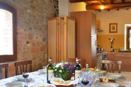 Il Giogo - Open plan kitchen/dining room leading out to the terace.