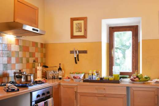 Il Giogo - The large well equipped kitchen on the ground floor.