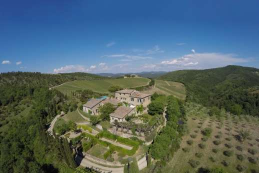 Il Trebbio - The lovely old building sits on a hilltop surrounded by rolling hills just minutes away from Castellina-in-Chianti.