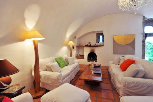 Il Trebbio - Large sitting room with an open fireplace.