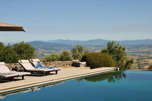 I Poggi  - The private swimming pool, 13 x 8 meters/42 x 26 feet, is set on a paved terrace some 60m/200 feet from the main house.