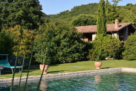 Poggitello - The pool terrace on an open sweep of lawn on a gentle hillside.