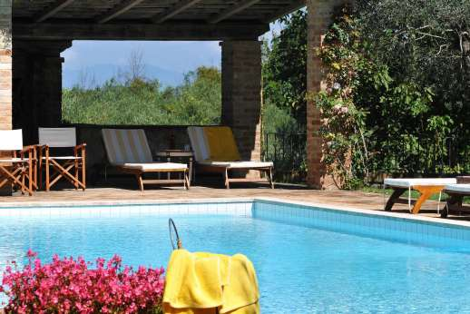 Podere Santa Giulia  - The swimming pool is set on a terrace above the main house.