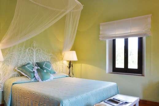 Tenuta il Poggio - A double bedroom.