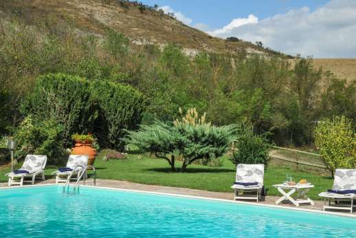Villa Le Focaie - The 7 x 14m swimming pool with a diving board, is set on a sunny stone terrace about 10m/30 feet from the villa.
