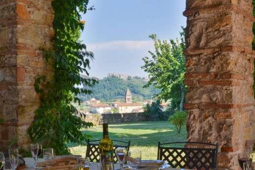Villa Poggio ai Cipressi - A wonderful shaded dining loggia.