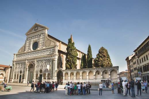 Arno Gondola Ride - A crowd of people gather around the Basilica of Santa Maria Novella on a clear, blue day.