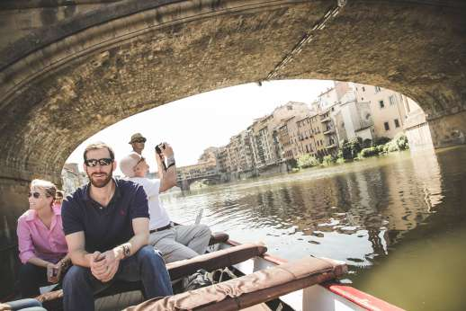 Arno Gondola Ride - A group of tourists enjoy a gondola tour along the Arno.