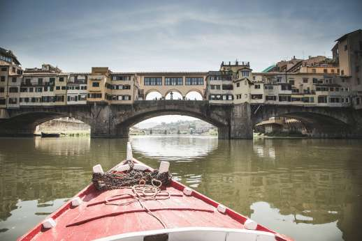 Arno Gondola Ride - A red gondola approaches Ponte Vecchio.