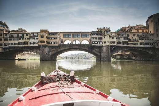 Arno Gondola Ride - A red gondola approaches Ponte Vecchio.