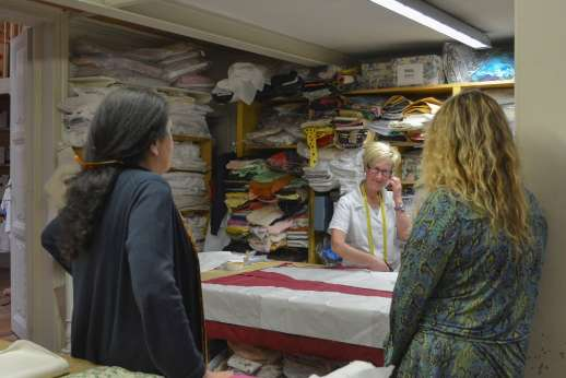 The Artisans of Florence - Women during a workshop in Tuscany discussing with an Florentine artisan