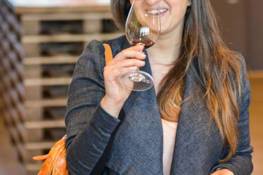 Chianti Wine Tour - A lady enjoys wine tasting as part of the vineyard tour