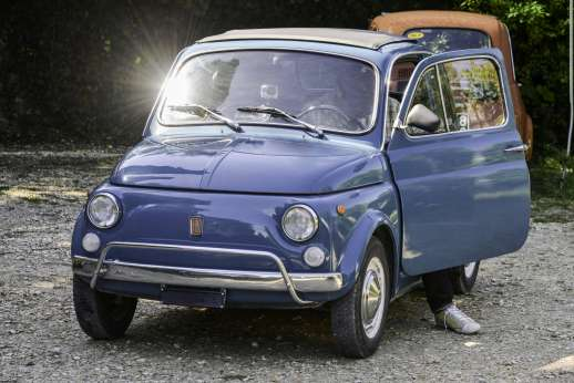 Fiat 500 Tour - A blue, classic Fiat 500 with the driver's door open