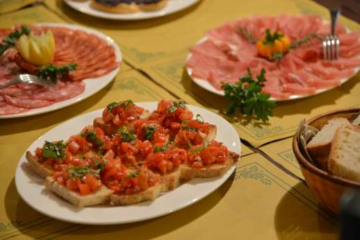 Fiat 500 Tour - A selection of traditional, Italian meats and breads are laid out on a table