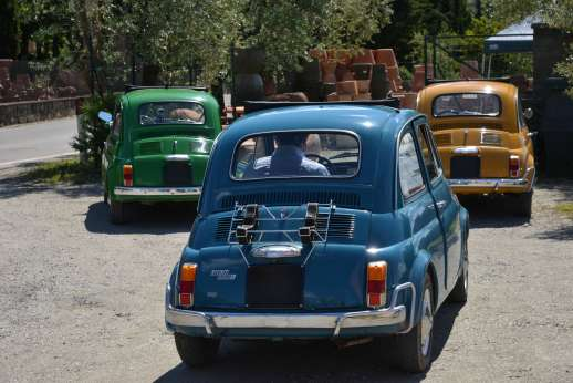 Fiat 500 Tour - Three Classic Fiat 500s parked.