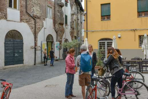 Lucca By Bike Or Foot - A cycle tour guide stops to talk to her group about Lucca's historic surroundings.