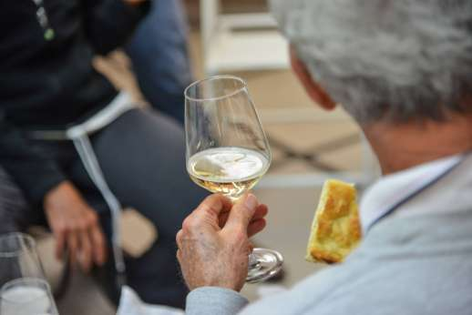 Lucca By Bike Or Foot - A tour group stop and enjoy Italian white wine and bread.