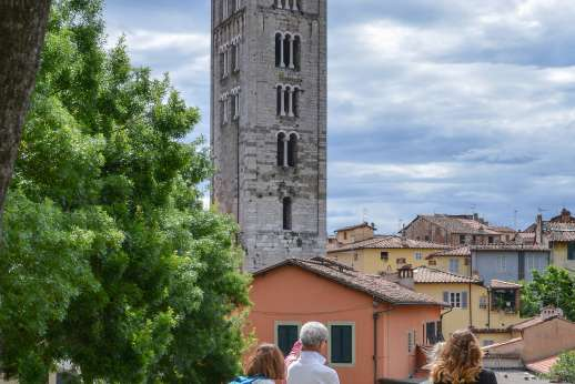 Lucca By Bike Or Foot - An historic tower in the middle of a residential area in Lucca