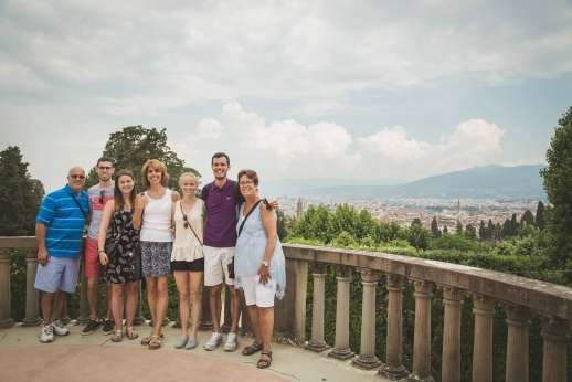 Pitti Palace & Boboli - A group of tourists visit Pitti Palace on a cloudy day