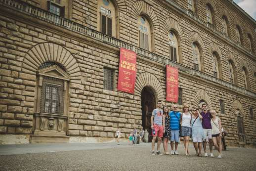 Pitti Palace & Boboli - A group of tourists pose for a photograph outside of Pitti Palace.
