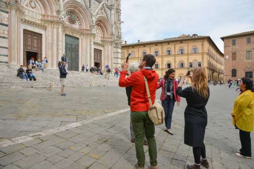 Siena Beyond The Palio - Tourists taking photos in the Piazza del Campo