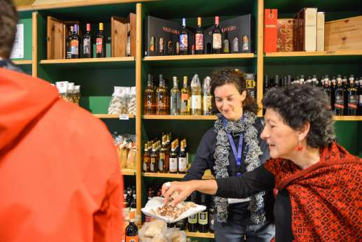 Siena Beyond The Palio - People trying food in a local shop in Siena