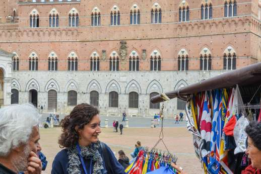 Siena Beyond The Palio - Tourists at a market stall in the Piazza del Campo