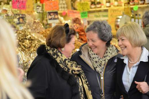 Florence Market Tour - Three women laugh in an Italian market