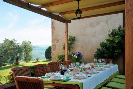 San Leolino (x 12 people) with Staff and Cook - The paved terrace furnished for dining al fresco.