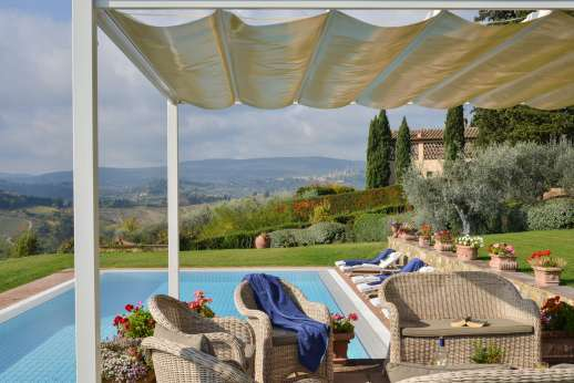 San Leolino (x 12 people) with Staff and Cook - The medieval city of San Gimignano with its towers sits as a back drop to the large infinity-edge swimming pool.