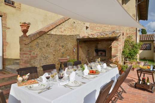 San Leolino (x 12 people) with Staff and Cook - SHaded outside eating by the villa which overlooks the garden and pool