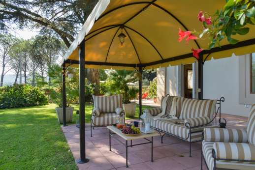 Villa Zacconi - Peace and tranquility with sitting and dining areas clustered under canvas and wooden pergolas.