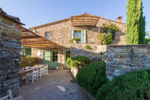 Villa Ambra - A beautiful stone villa with shaded outside eating area.