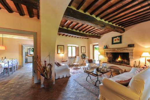 Casa al Bosco - The large ground floor living room with an open fireplace.