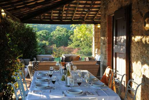 Casa al Bosco - Dine al fresco beneath the shaded loggia.