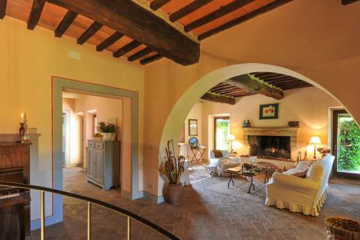 Casa al Bosco - Another view of the living room leading out to the loggia.