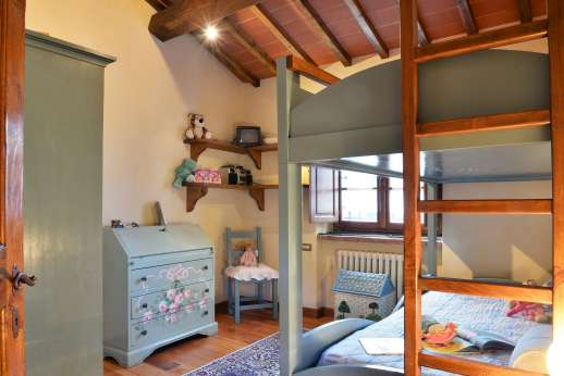 Casa Paggetti - The kids room with bunk beds and air conditioning.