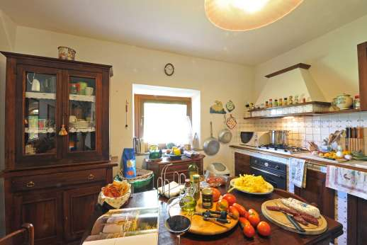 Casale Montecimbalo - A well-equipped kitchen and a pantry.