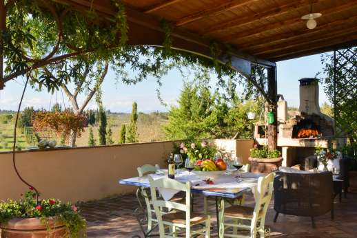 Colli Fiorentini - The dining loggia with lovely views across the valley.