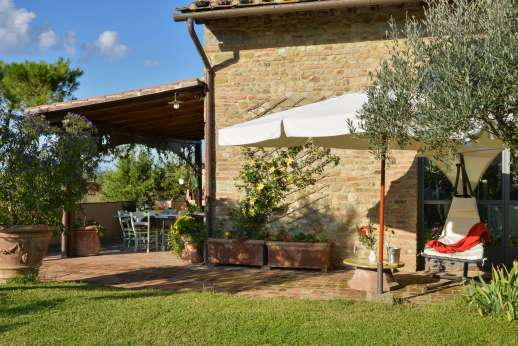 Colli Fiorentini - A Loggia furnished for lounging and dining.