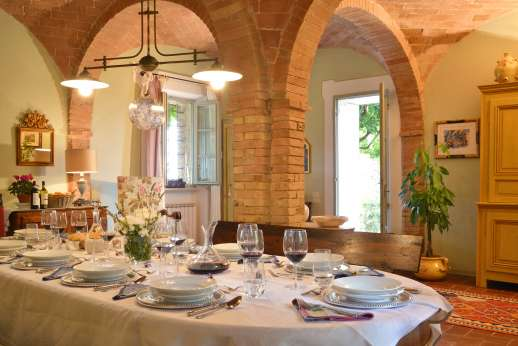 Geggianello - A large dining room with ached and vaulted ceilings.