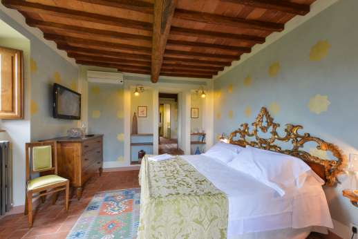 I Corbezzoli - Another view of the first floor bedroom showing working open fire.