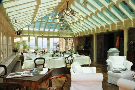 Weddings at I Corbezzoli - Enjoy delicious meals in this bright an airy dining room.