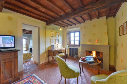 A Cooking Week at I Corbezzoli - I Pini first floor bedroom showing working open fire